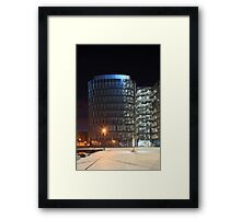 building with  glass at night Framed Print