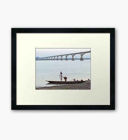 Boatmen at the river bank Framed Print