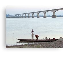 Boatmen at the river bank Canvas Print