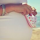 Baby Booties on a Baby Bump on the Beach by Laurie Search