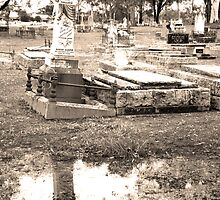 cemetery reflection sepia (wm) by Ike Faithfull