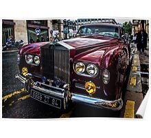 A red Rolls Royce parked on the street in Paris. Poster