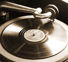 Old Phonograph with a Record Album by Mike  McGlothlen