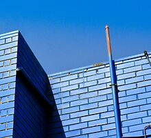 Blue On Blue. Wall And Pipe On Sky. by Raymond J. Marcon