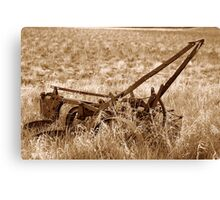 Sepia Antique Plow Abandoned in a Field Canvas Print