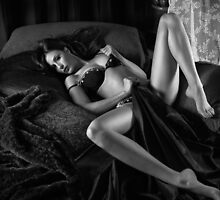 Beautiful sexy woman in lingerie lying on bed Black and white art photo print by ArtNudePhotos