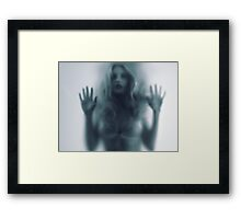 Blurred young woman silhouette behind glass art photo print Framed Print