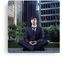 Young businessman meditating in city downtown art photo print Canvas Print