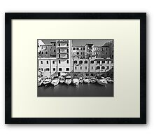 The marina in the city Framed Print
