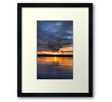 Sundown over an lake Framed Print