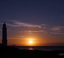 Corsewall Lighthouse at Sunset by Maria Gaellman