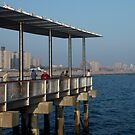 Fishing on the Pier in Coney Island by Russell Fry