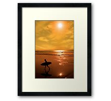 silhouette of surfer walking from the sea Framed Print