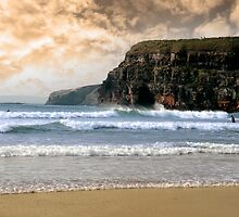 surfers near cliffs before a storm by morrbyte