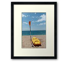 Kayaks on Beach Framed Print
