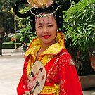 A Chinese Model Showing Off A Colourful Costume. Xi'an, China. by Ralph de Zilva