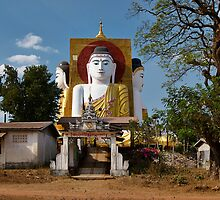 four sitting Buddhas 30 metres high looking in four points of the compass at Kyaikpun Pagoda by travel4pictures