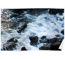 A breaking surge of sea water over rocks Poster