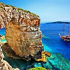 Cruising by the natural rocky arch of Trypitos by Hercules Milas