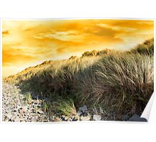dramatic sunset on rocky beal beach Poster