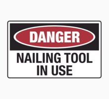 Danger Nailing tool in use by monsterplanet