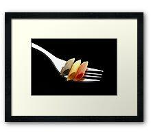 italian penne pasta on a fork on black background Framed Print