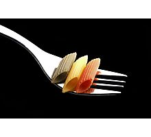 italian penne pasta on a fork on black background Photographic Print