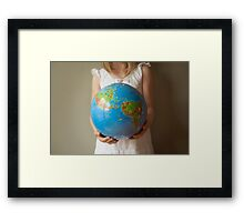 The whole world in her hands Framed Print