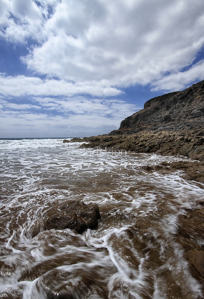 Waves breaking round a rock by Judi Lion