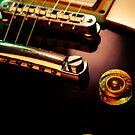 Electric guitar strings and bridge closeup by sumners