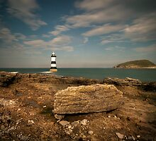 Penmon Point Lighthouse and Puffin Island by eddiej