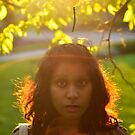 Pretty Girl With Big Brown Eyes Looking Into Camera, In Front of Sunset by Handy Andy Pandy