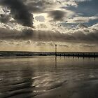 Sun rays through the clouds by Judi Lion