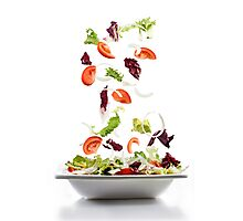 Salad with fresh vegetables falling on plate Photographic Print