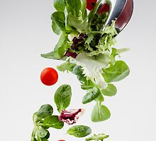 Fresh salad falling from a clamp by paulrommer
