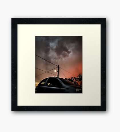 Hatchback vs the Apocalypse  Framed Print