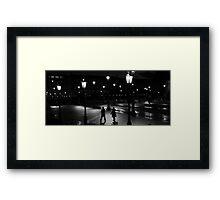 Walkers in the night Framed Print