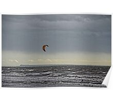 A Lone Kite Surfer Flying Across Stormy Seas Poster