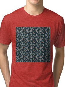 Drawn bird feathers on dark background seamless pattern Tri-blend T-Shirt