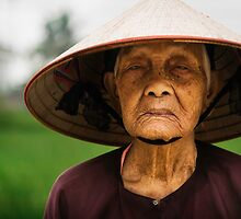 Pensive: Rice Farmer in Small Villiage, Vietnam by thewaxmuseum