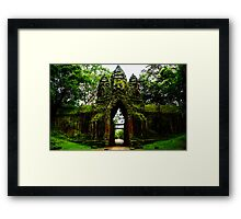 Guarded Gate: Heads at Angkor Thom, Cambodia Framed Print