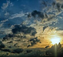 Sun setting behind the stormy clouds by derejeb