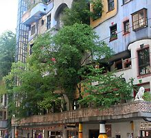 Building by Hundertwasser from the right side with the tree, Vienna by Ilan Cohen