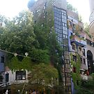 Building by Hundertwasser from the left side with the street sign, Vienna by Ilan Cohen