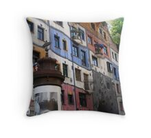 Front of a colourful building by Hundertwasser, Vienna Throw Pillow