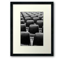 Plastic black chairs under rain Framed Print