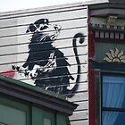 San Francisco - Banksy rat on a roof by Maureen Keogh