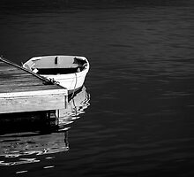 Dingy at the dock by woodnimages