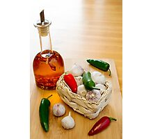 Garlic and Chilli Basket With Oil Photographic Print