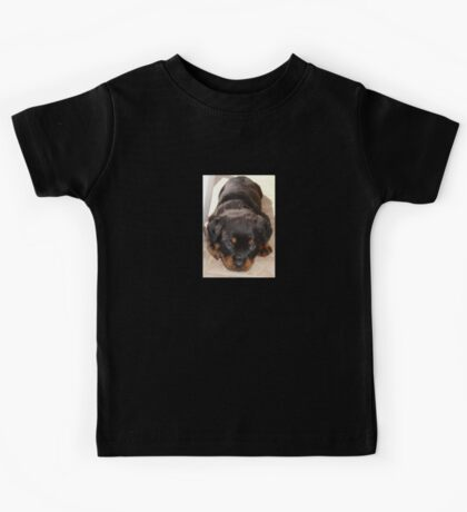 Cute Rottweiler Puppy With Head On Paws Kids Tee